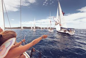Girls cheering at yachts in Regatta